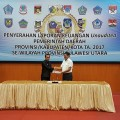 Penyerahan dokumen LPKD 2017 Bolmut kepada BPKRI