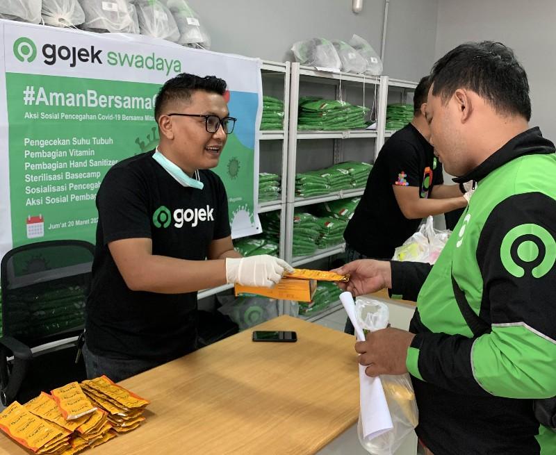 Gojek Manado lengkapi Mitranya dengan Masker dan Vitamin